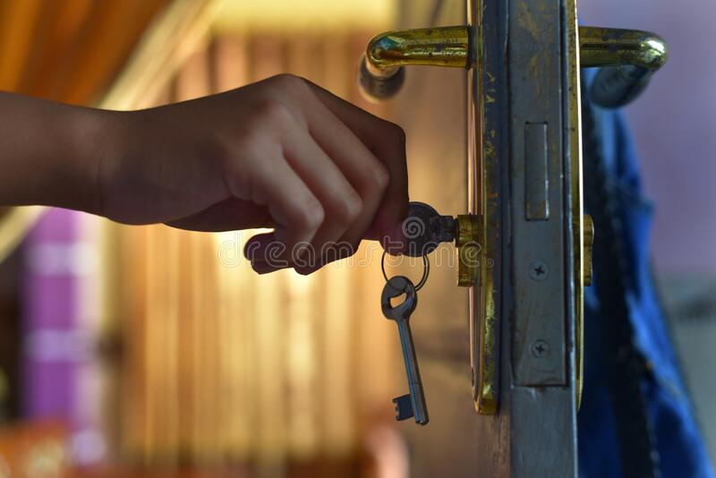 Hand hold the door key stock photography