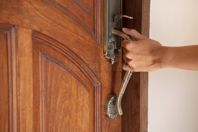 Hand hold handle of door royalty free stock images
