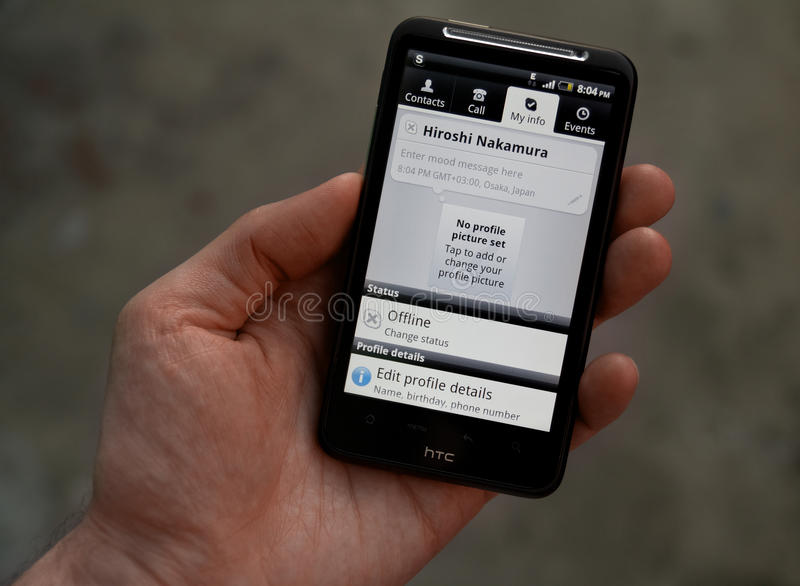 Download Hand Hold HTC Desire HD With Skype Profile Editorial Photography - Image: 19625177