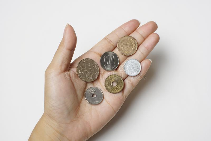 Isolated Hand Hold Money Japanese Coin. Exchange Rate 500, 100, 50, 10, 5 and 1 yen. stock images