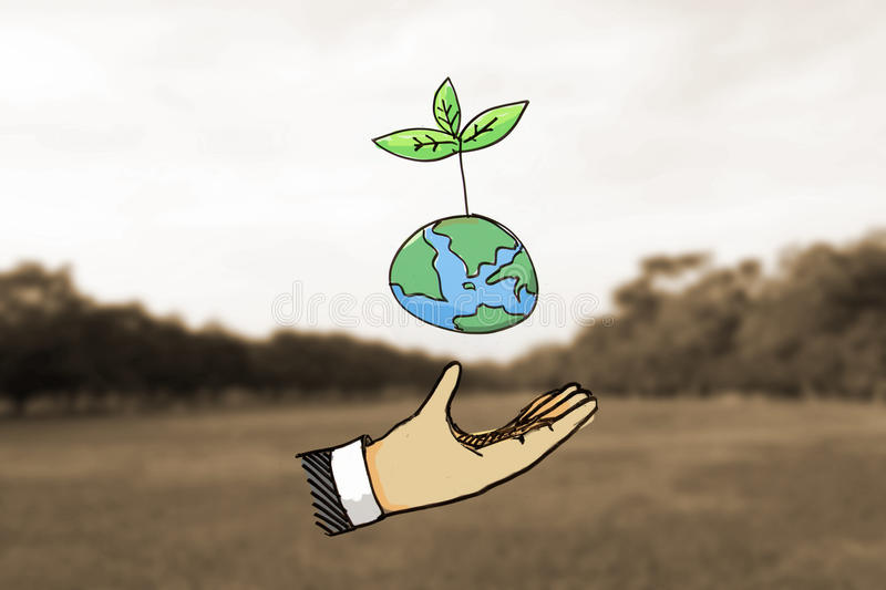 Hand hold plant on earth. stock image