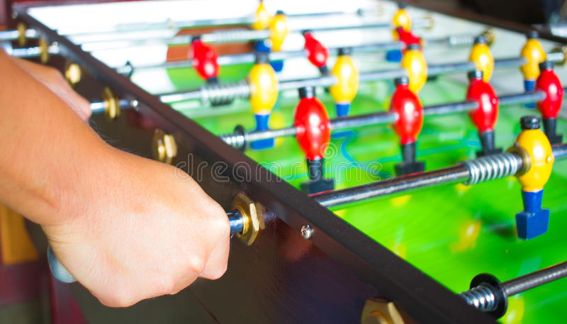 Hand hold and play a tabletop soccer stock photos