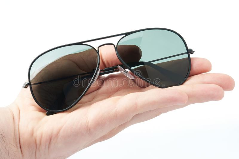 Hand hold polarized sunglasses stock photo