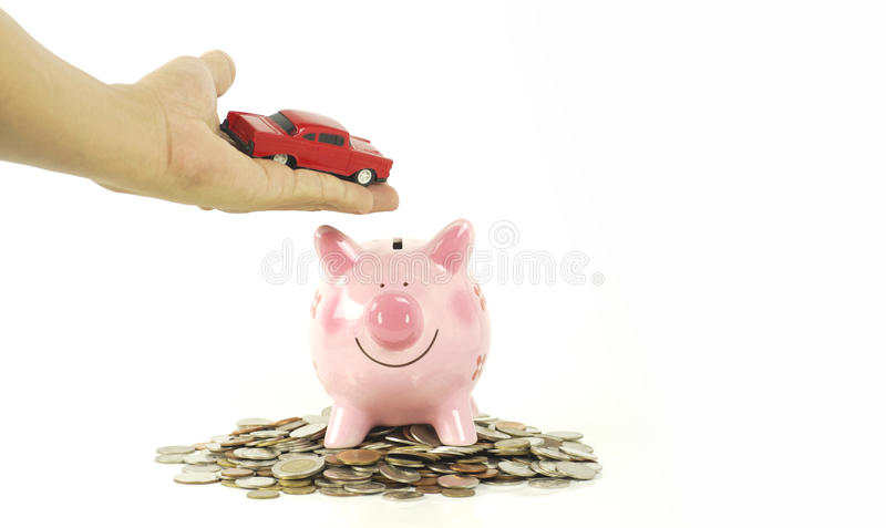 Hand hold red toy car and pink piggy. Bank isolated on white background, concept in save money and coin, finance, sell and buy vehicle stock photos