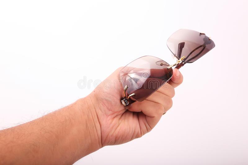 Hand hold Sunglasses stock photos