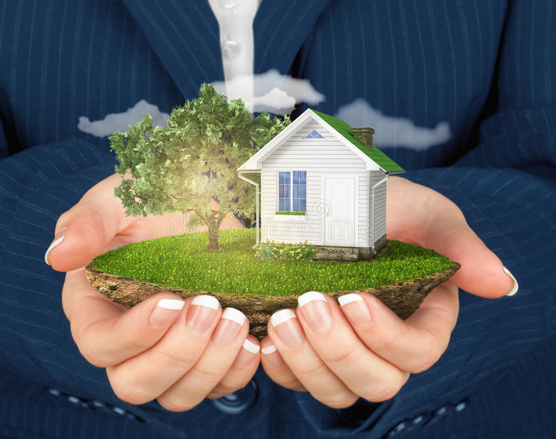 Hand holded beautiful small island with grass. And tree and house levitating in the sky stock photos