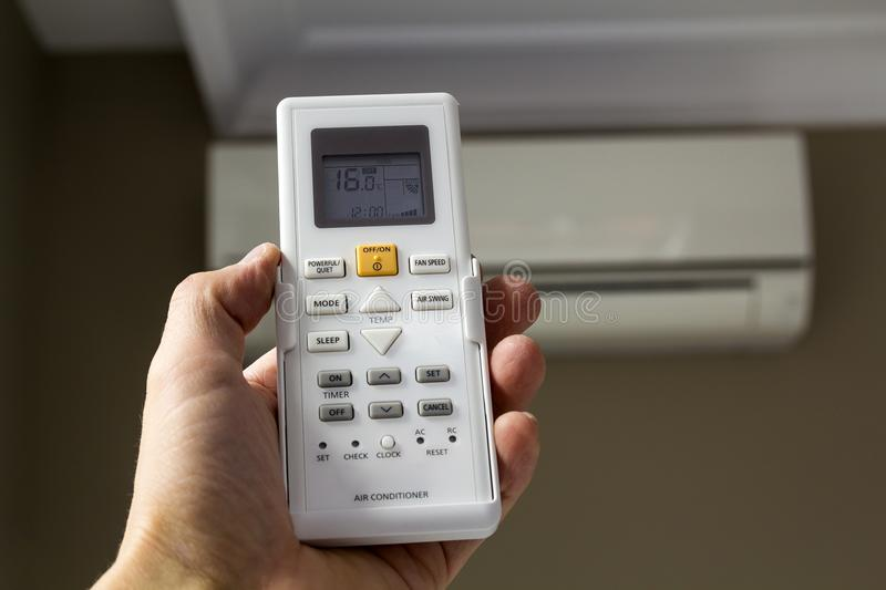 Hand holdind control switch of home air conditioner stock image