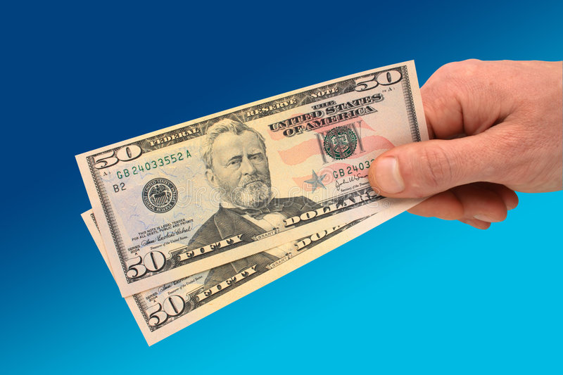 Hand holding $50 banknote stock photo