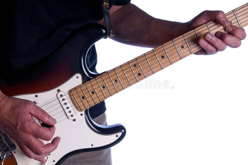 A hand holding a guitar. A hand holding an accoustic guitar stock image