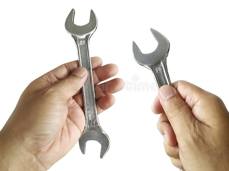 Hand holding Adjustable spanner or adjustable wrench isolated on white background royalty free stock photos