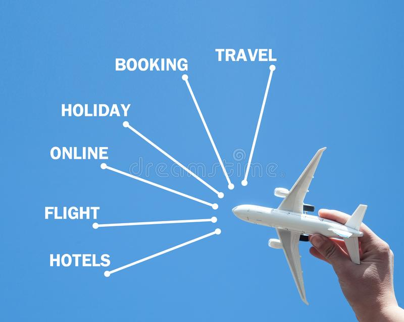 Hand holding airplane. Booking. Travel stock image