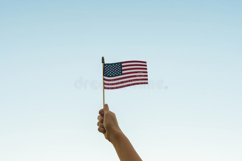 Hand holding American flag royalty free stock photos