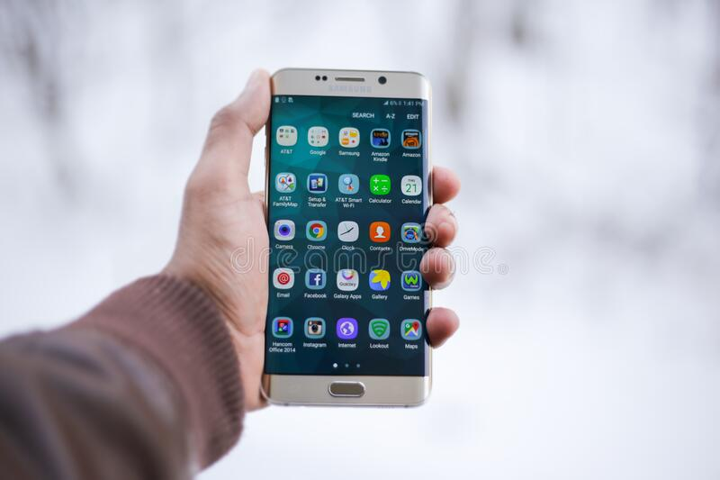 Hand holding Android smartphone royalty free stock photography