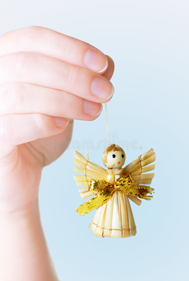 Hand Holding Angel Ornament stock images