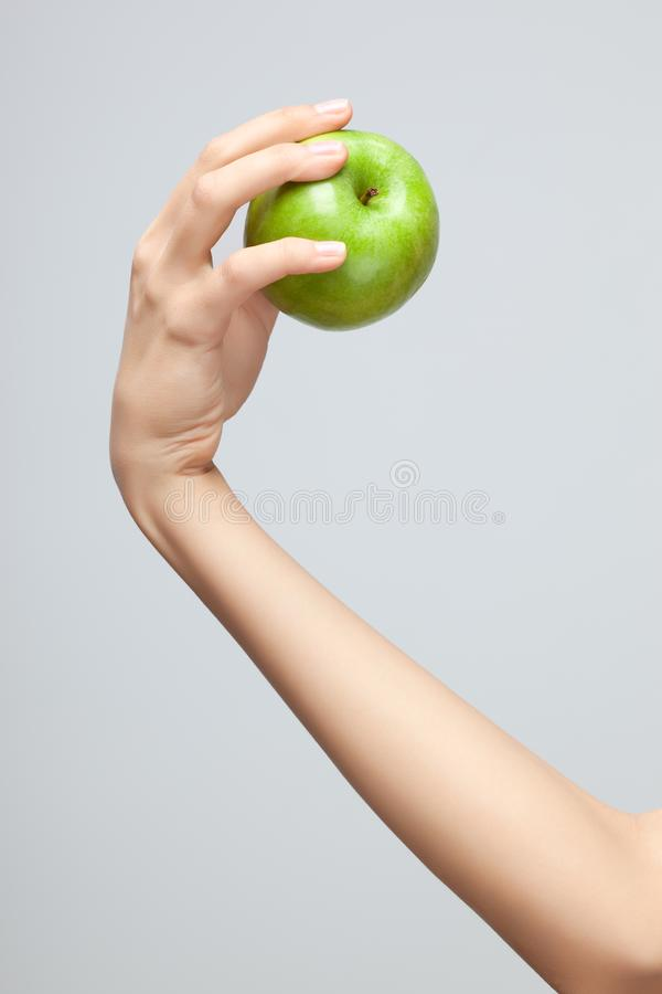 Hand holding apple. royalty free stock photography