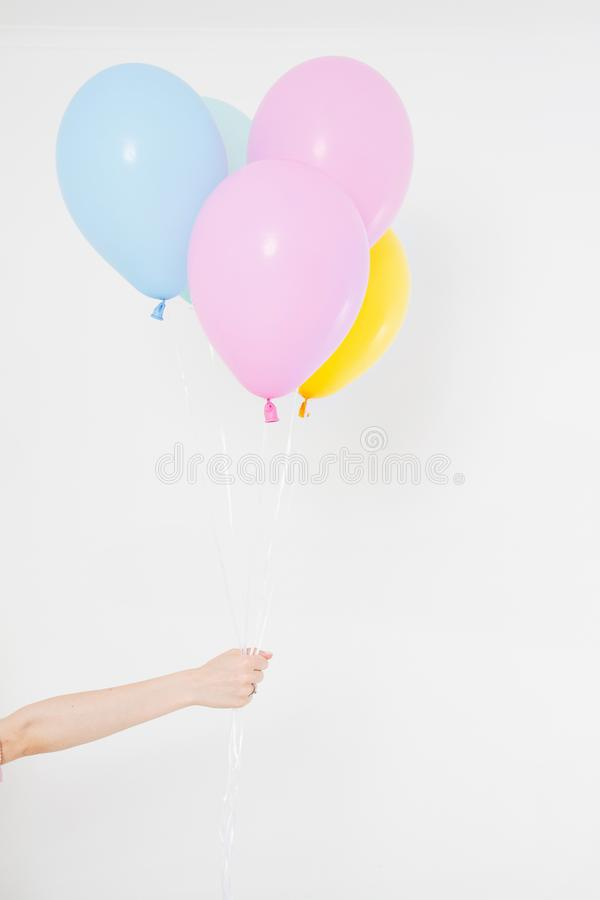 Hand holding balloons. Holiday concept. Colorful party balloons background. Isolated on white. Copy space royalty free stock photos