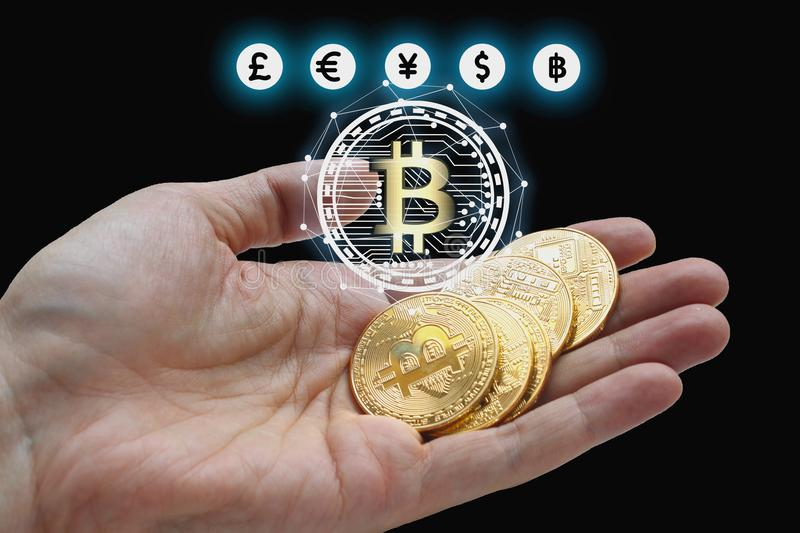 Hand holding bitcoin and blockchain digital technology. On a black background, currency blockchain technology concept royalty free stock photos