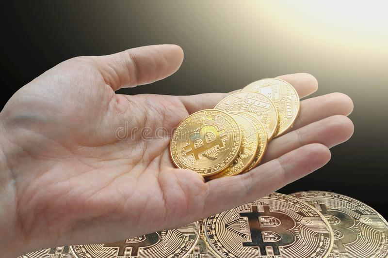 Hand holding bitcoin and blockchain digital technology. On a black background, currency blockchain technology concept stock images