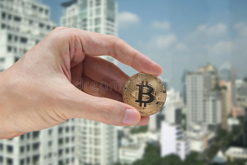 Hand holding the bitcoin and blockchain network connection with. City background, virtual currency blockchain technology concept. virtual currency blockchain royalty free stock photos