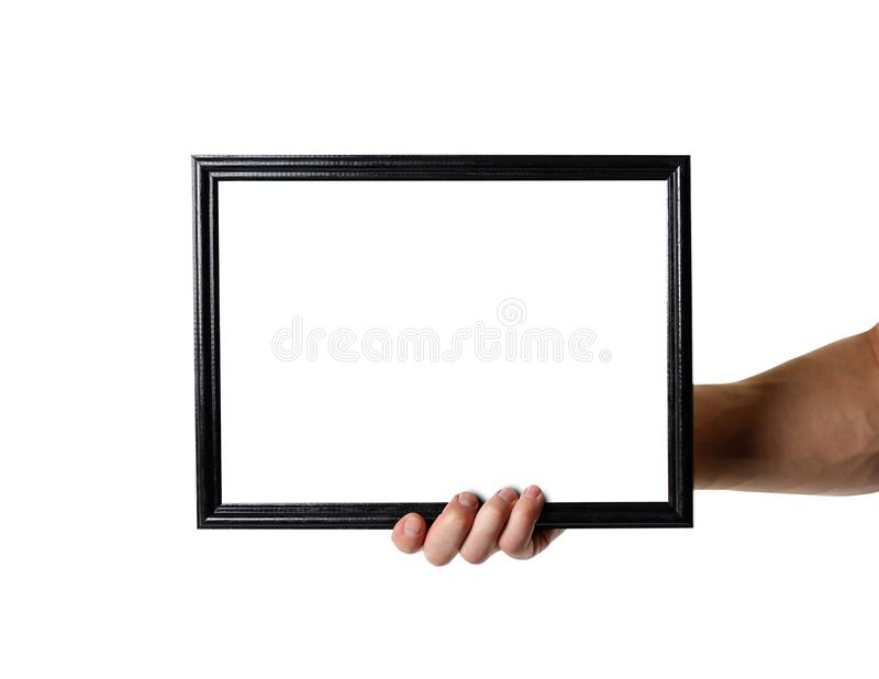 Hand holding black A4 frame. An empty frame with a white background. Close up. Isolated on white background stock photos