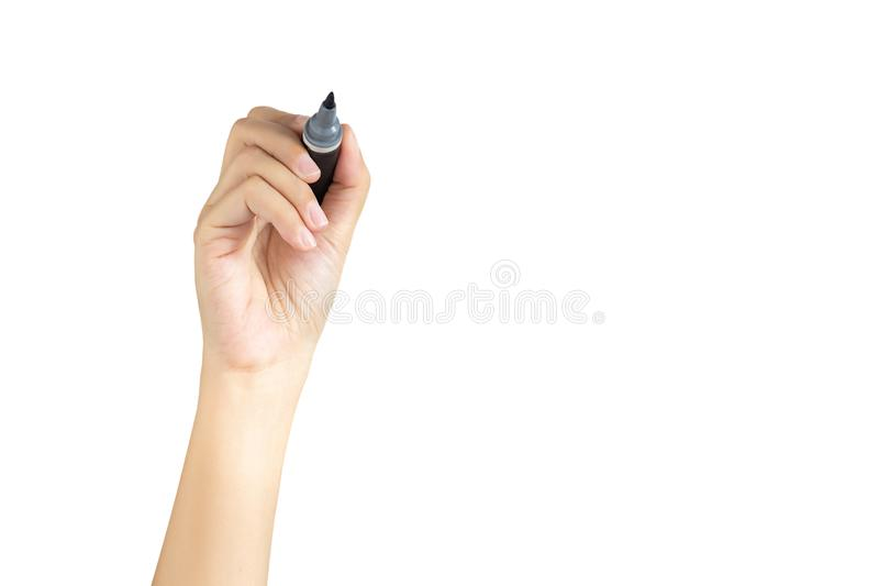 Hand holding black magic marker pen ready to writing something isolated on white background with copy space, studio shot, front royalty free stock image