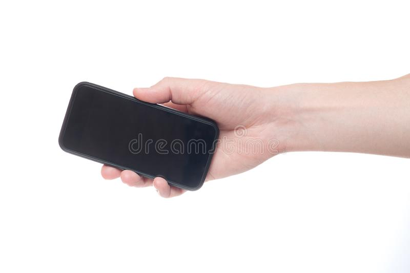 Hand holding black Smartphone with blank screen on white backgroun stock images