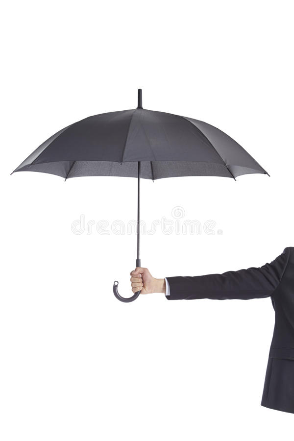 Hand holding black umbrella royalty free stock photography