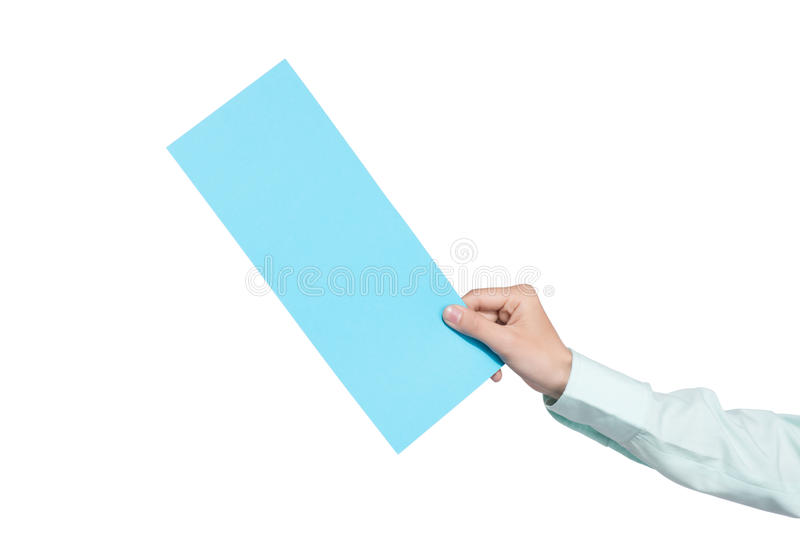hand holding blank airline boarding pass ticket isolated over white background stock photo