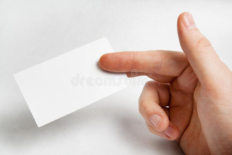 Hand holding blank business card. Over white stock photos