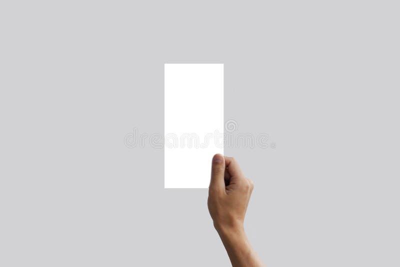 Hand holding blank flyer brochure booklet. Leaflet presentation. Pamphlet hands businessman. Man show offset paper. Sheet template royalty free stock image