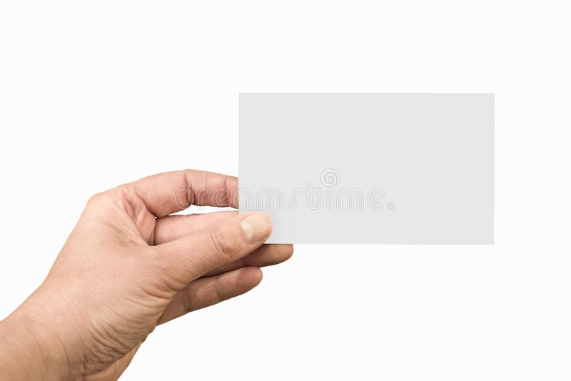Hand holding a blank note or business card isolated on white stock photo