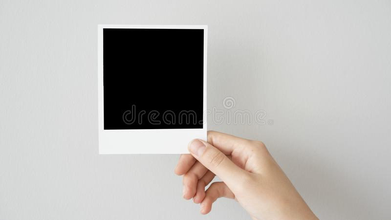 Hand holding blank photo frame stock photos