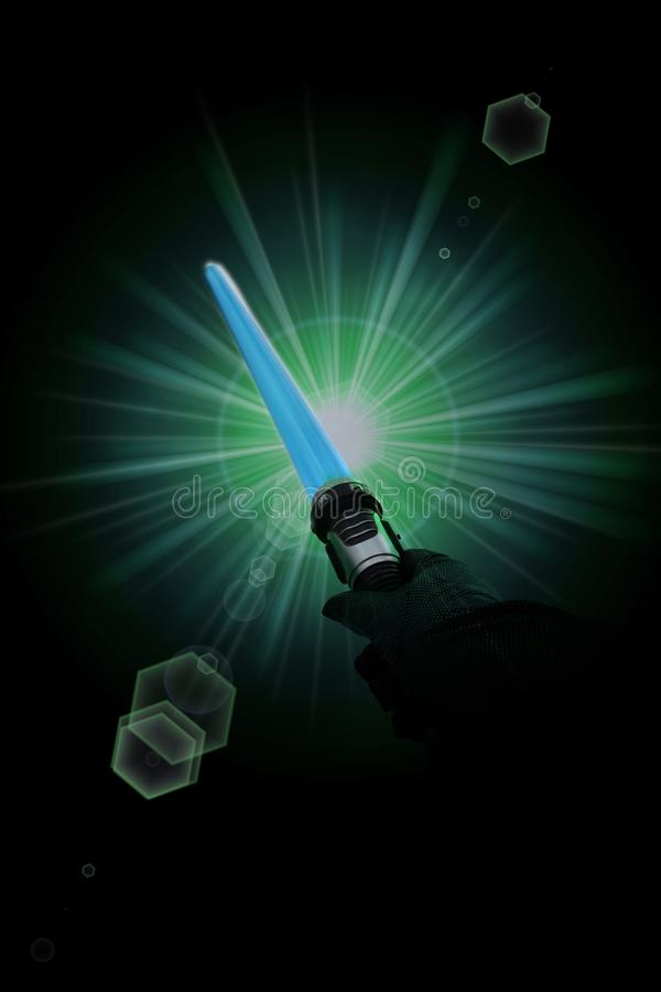 Hand holding blue light saber. Hand with black gloves holding blue light saber in front of green exploding colors stock photography