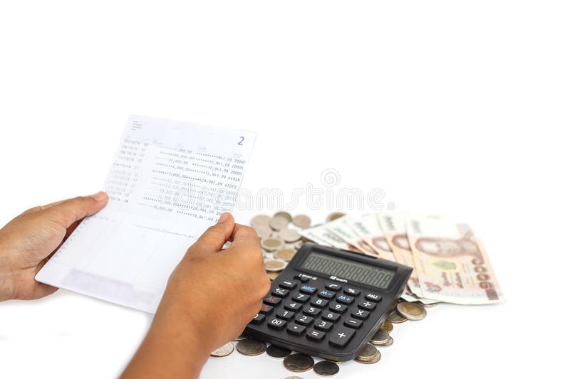 Hand holding book bank and stack of money in consept checking mo royalty free stock image