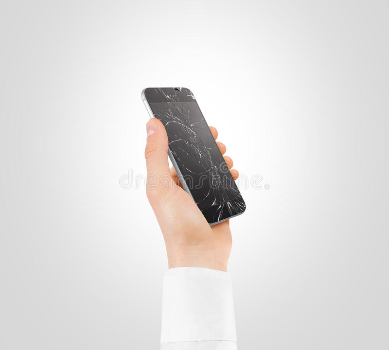 Hand holding broken phone smashed touch screen display cipping path. Arm hold cracked monitor smartphone isolated. Smart mobile cellphone scratch. Telephone royalty free stock photo