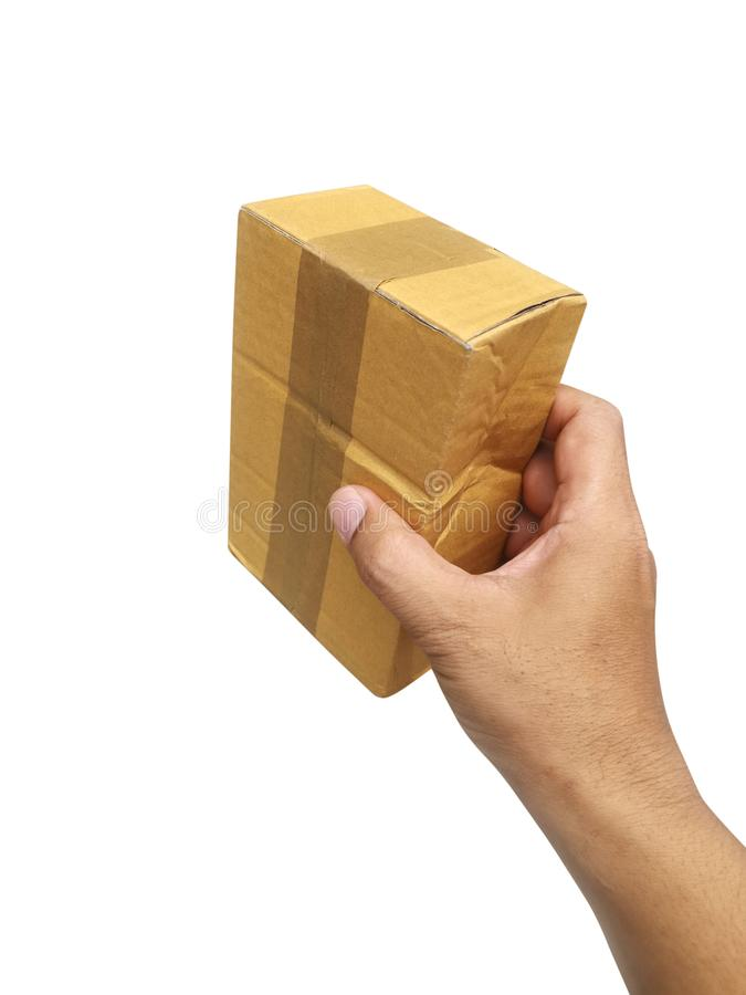 Hand holding brown paper box package isolated on white background royalty free stock image