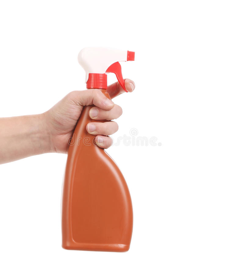Hand holding brown plastic spray bottle. royalty free stock image