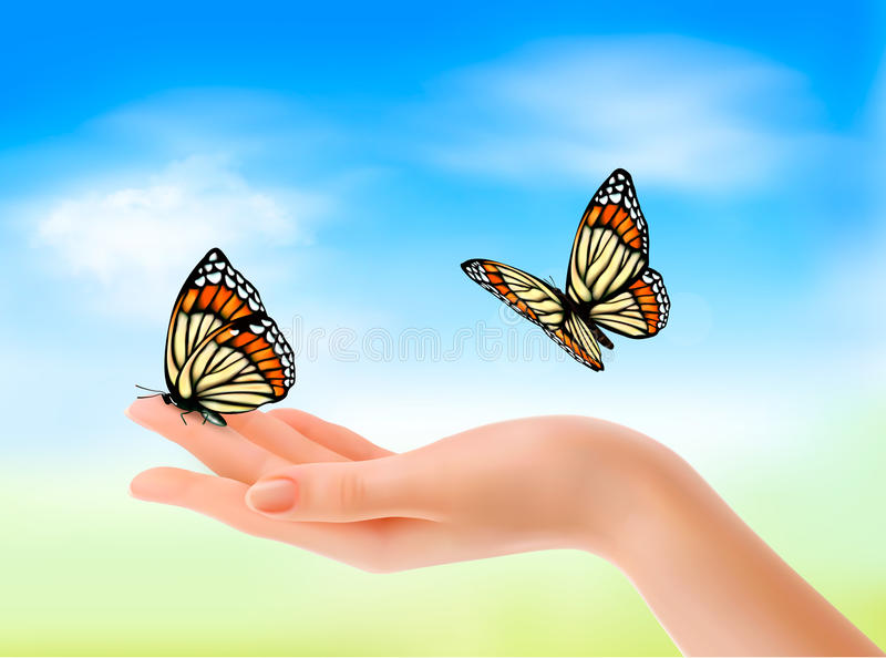 Hand holding a butterflies against a blue sky. royalty free illustration