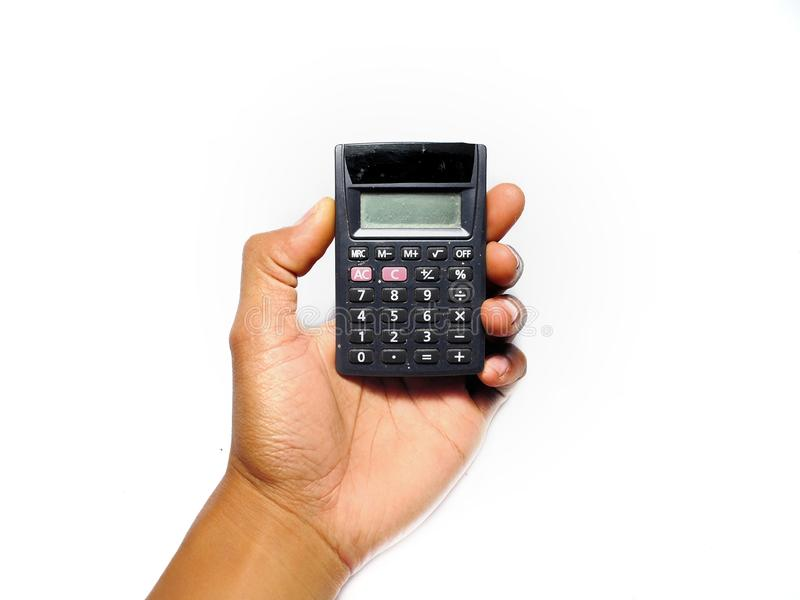 Hand holding calculator isolated on white royalty free stock images