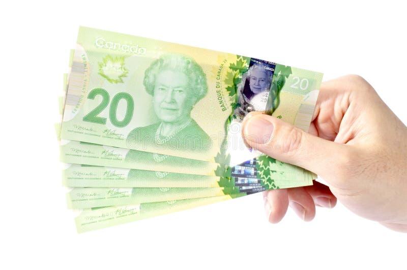 Hand Holding Canadian Twenty Dollar Bills #1 stock images