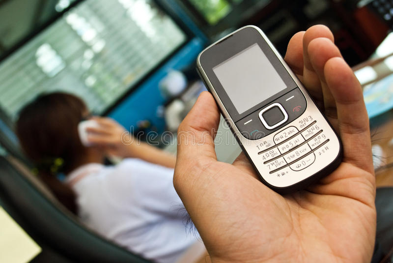 Download Hand holding a cell phone stock photo. Image of keyboard - 15481308