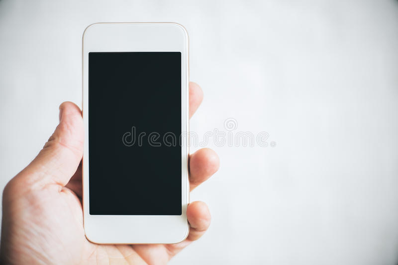 Hand holding cellphone royalty free stock image