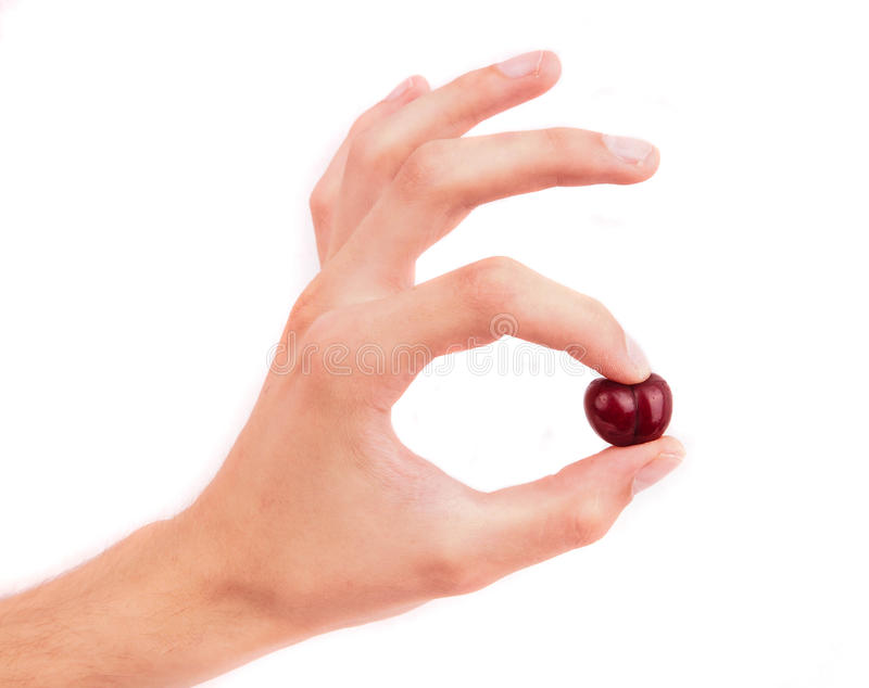 Hand holding a cherry. isolated on white background stock images