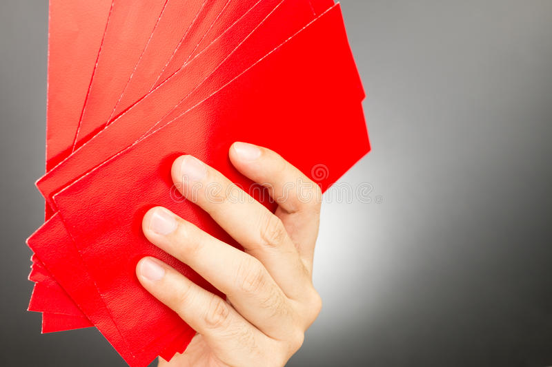 Hand holding Chinese Red Envelope. In Chinese new year festival stock photo