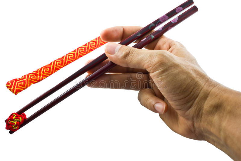 Hand holding chopsticks isolated royalty free stock photo