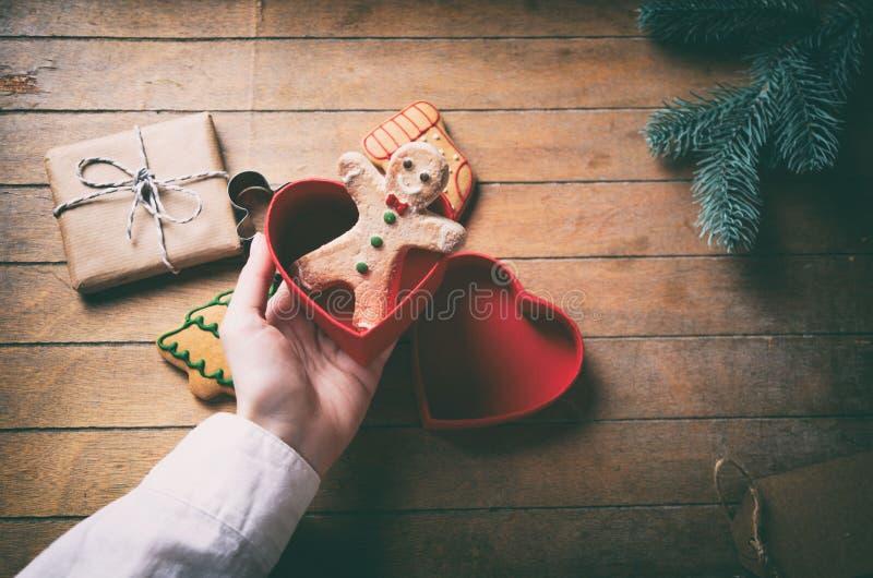 Hand holding christmas gingerbread man stock photos