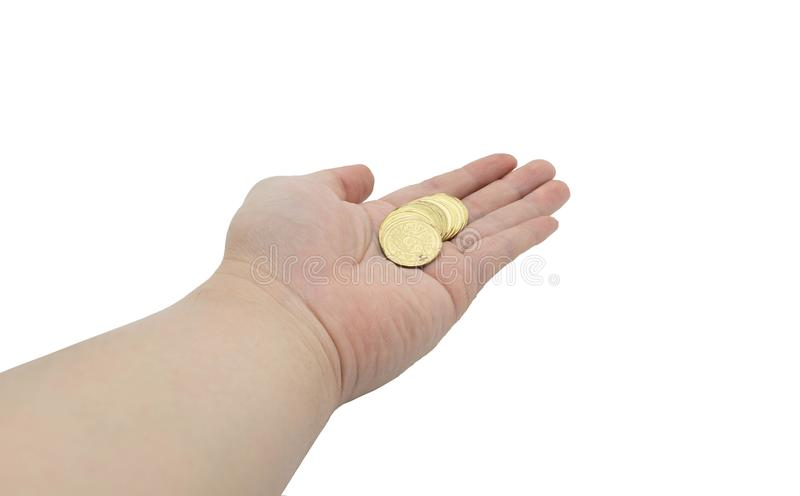 Hand holding coin on palm side in money management concept on is. Olated white background with clipping path royalty free stock photos