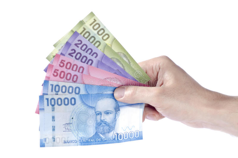 Hand Holding Colorful Chilean Pesos royalty free stock images