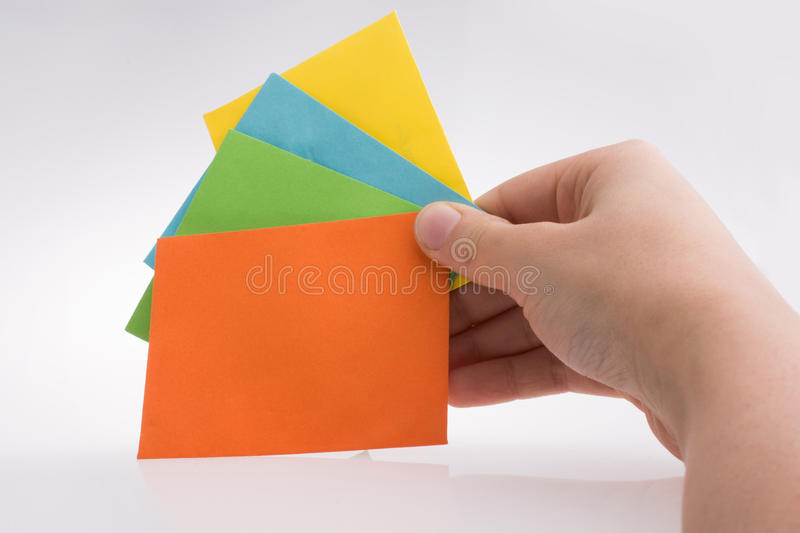 Hand holding colorful envelops in hand royalty free stock images