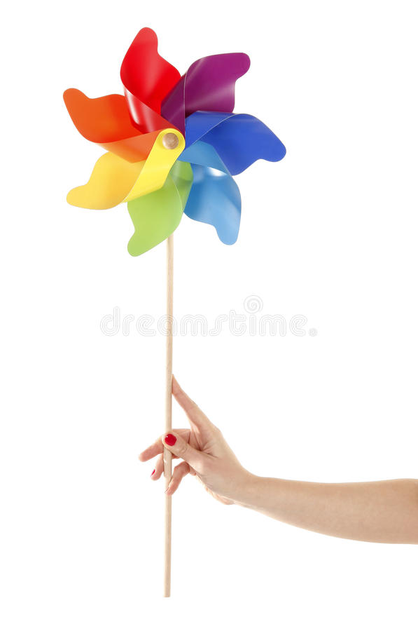 Hand is holding colorful pinwheel toy royalty free stock image